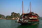A junk in bay, Ha Long Bay, Vietnam