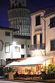 Restaurant and Leaning Tower at night, Pisa, Tuscany, Italy