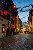 Lane Konviktgasse with Christmas decoration, old town, Freiburg im Breisgau, Baden-Wurttemberg, Germany