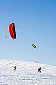 Snowkiters at mount Schauinsland, Freiburg im Breisgau, Black Forest, Baden-Wurttemberg, Germany