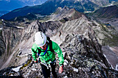 Mountaineer at north ridge, Acherkogel, Stubai Alps, Tyrol, Austria