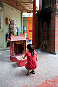 Young woman with incense sticks in a Chinese Temple, Kuala Lumpur, Malaysia, Asia