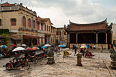 Trishaws on square in front of Kongsi Clan Temple, Georgetown, Penang, Malaysia, Asia