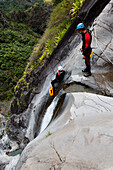 People canyoning at Canyon du Fleur Jaune bei Cilaos, La Reunion, Indian Ocean