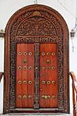 View of carved wooden door in the Stonetown, Zanzibar City, Zanzibar, Tanzania, Africa
