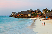People on the beach and the Z hotel at dusk, Nungwi, Zanzibar, Tanzania, Africa