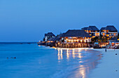 Beach and the illuminated Z Hotel in the evening, Nungwi, Zanzibar, Tanzania, Africa