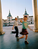 Kids playing on the town square, Plaza Mayor, El Burgo de Osma, Castile and León, Spain