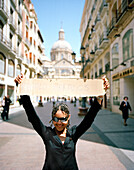 Girl offering free hugs, c/Don Allfonso, Saragossa, Aragon, Spain
