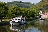 Le Boat Nautilia houseboat on Canal de la Marne au Rhin, Lutzelbourg, Lorraine, France