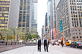 Two young jewish men on the walkway, pedestrians, sky-scraper, advertisment, Manhattan, New York City, United States of America, USA