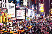 Times Square at night, yellow cabs and Illuminated Advertising, Manhattan, New York City, United States of America, USA
