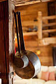Two old rustic pans on wooden post, Tyrol, Austria