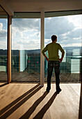 Mid adult man looking out of a window, Styria, Austria