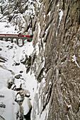 Glacier Express in winter near Andermatt, Canton of Uri, Switzerland