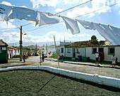 Clothesline in the wind in front of fishermen's houses, coastal town Rabo de Peixe, Sao Miguel island, Azores, Portugal