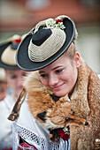 Woman wearing traditional costumes, festival of Leonhardiritt, Benediktbeuren, Bavaria, Germany