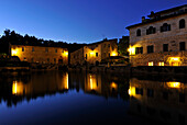 Houses and water basin in the evening, Bagno Vignoni, San Quirico d'Orcia, Tuscany, Italy, Europe