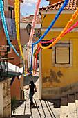 Garlands between houses, Alfama, Lisbon, Portugal