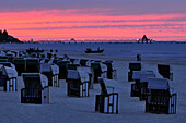 Beach chairs in the afterglow, Heringsdorf pier, Usedom, Mecklenburg-Western Pomerania, Germany