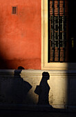 Shadow on red wall, Sevilla, Andalusia, Spain, Europe