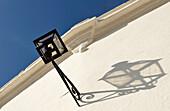 Lantern on white wall, Sevilla, Andalusia, Spain, Europe