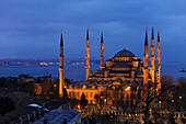 Illuminated Blue Mosque (Sultan Ahmed Mosque) in the evening, Istanbul, Turkey
