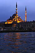 The illuminated Yeni Valide Camii mosque in the evening, Istanbul, Turkey, Europe