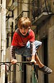 Boy at Alfama quarter, Lisbon, Portugal, Europe