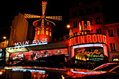 The illuminated music hall Moulin Rouge at night, Paris, France, Europe