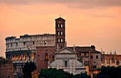 Basilica of Saint Mary in Cosmedin and Colosseum in the afterglow, Rome, Lazio, Italy