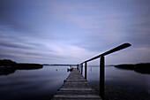 Deserted jetty at dusk, Neeberg, Achterwasser, Usedom, Mecklenburg-Western Pomerania, Germany, Europe