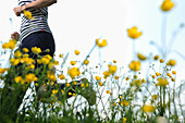 Woman jogging through a meadow, Upper Bavaria, Bavaria, Germany