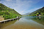 Anglers standing on landing stage in lake Afritzer See, lake Afritzer See, Carinthia, Austria, Europe