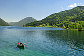 Two persons rowing a boat on lake Weissensee, lake Weissensee, Carinthia, Austria, Europe
