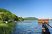 Wooden landing stage and boathouse at lake Klopeiner See, lake Klopeiner See, Carinthia, Austria, Europe