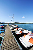 Wooden landing stage with sailing boats and pedal boats, lake Woerthersee, Carinthia, Austria, Europe