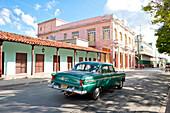 Street scene with American oldtimer car, Ciego de Avila, Ciego de Avila, Cuba