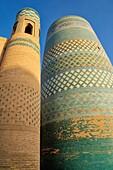 Kalta Minor minaret in the historic adobe oldtown of Khiva, Chiva, Silk Road, Unesco World Heritage Site, Uzbekistan, Central Asia
