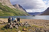 group of tourists at a historic Inuit foodcache at North Arm of Saglek Fjord, Torngat Mountains National Park, Newfoundland and Labrador, Canada