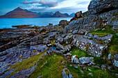 Scotland, Isle Of Skye, Elgol Looking across the rocky shoreline north of Elgol towards the peaks of the Black Cuillins