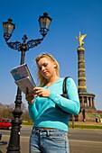 Berlin City, Deutschland, Germany, Girl Looking at Map, Lost, Tourist, Deutschland, Young, Woman, Blonde Woman, with Map, Tourist, Look, Looking, Find, City, Break, Europe, travel, Europa, Capital, Alone, Architektur, Ausflugziel, Berlin, Deutschland, Gro