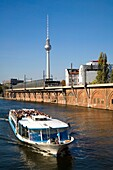 Tv Tower from Spree Canal with Boat in the Forground Berlin Germany
