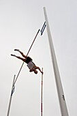 Pole Vaulter attempting to clear the bar, Arc de triomf Competition, Barcelona, Spain