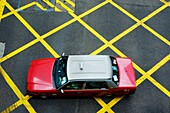 China hong kong island a red taxi cab driving on yellow lines