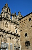 Facade of Real Clericia de San Marcos on left and Public Library on right with scallop, Spain Salamanca