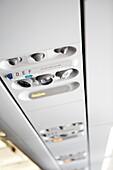 Console traveler aboard a plane