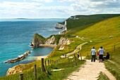 Image of hiker on the way to theDurdle Door,  near Lulworth, Dorset, South England