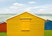 Brightly Coloured Beach Huts at the Beach of Whitstable on the North Sea coast of South East England