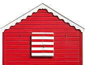 Isolated Colourful red white striped Beach Hut at the Beach of Southwold, England